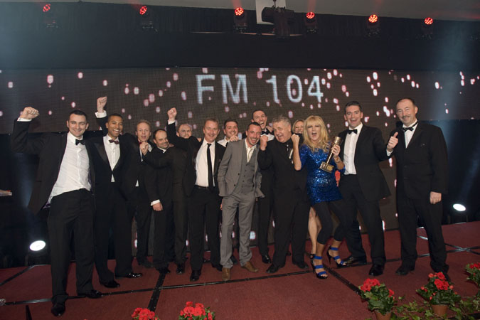 NO REPRO FEE. 13th October 2012. FM104 has been awarded the PPI Radio Awards 2012 Music Station of the Year 2012. Members of the station are pictured here celebrating on stage after receiving the award from Dennis Woods the Chairperson of PPI (right) at a ceremony held in Kilkenny last night. Pic Iain White - News - Ppi Music Station Of The Year 4159 Photography by Iain White, Photographer, Dublin 16